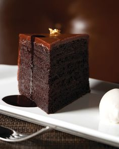 Mouth watering yet? @The Ritz-Carlton Chicago (A Four Seasons Hotel)'s Ten-Layer Chocolate Cake has achieved a cult-like following. One bite and you'll see why.