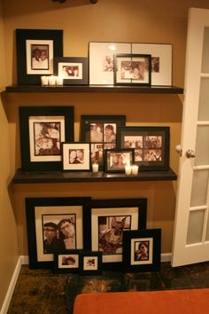 Great way to display family photos. I'm thinking of something similar beside the hallway. Displaying Family Pictures, Display Family Photos, Display Pictures, Family Pics, Picture Frame Display, Frame Wall Collage, Frames On Wall, Picture Wall, Photo Mural