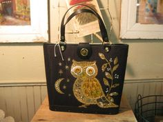 Amazing mid century embellished owl purse from Vendor 1018 in booth 206. Priced at 68.00. One of the beautiful items available at our Vintage Fashion Sale! 20% off all vintage clothing, shoes and accessories from July 18-26! Come join us for a fashion show to launch the sale! It's happening on Saturday July 18th at 2:00 PM in The Brass Armadillo Antique Mall - WheatRidge, CO!