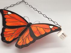 Stained Glass Monarch butterfly made with spectrum semi-translucent glass with a black finish