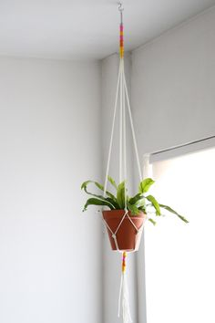 Use supplies from the hardware store to make this easy macrame plant hanger to hold your favorite houseplant. Get the step-by-step instructions at HGTV.com.