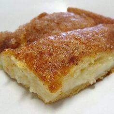 sopapilla cheesecake - pillsbury cresent rolls, cream cheese, sugar, vanilla, cinnamon and butter.