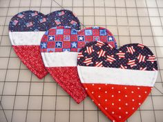 Set of 3    These heart mug rugs/coasters will add lots of charm to your patriotic holiday decor and picnics, or are perfect for every day use. They are also great to use as little doilies or candle mats, and youll love the sparkly fabric!    Mug rugs have been sewn/quilted with 100% cotton fabric and quilt batting. Size: Approx. 7 x 6    Custom orders welcome.    Handmade in my smoke free/pet free home. :)