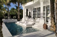 White marble paves an Egyptian-inspired Miami terrace and pool by interior designer Juan Montoya.Pin it.