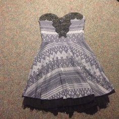 Free people dress size medium size medium navy with tulle underskirt, embroidered top, and Nordic pattern. Never before worn!! Free People Dresses Strapless