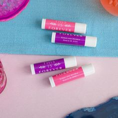 The hot sun can be damaging for the lips so delight your guests with personalized lip balms. Choose your favorite design, a color font, and personalize the lip balm with your names, and wedding date.  #LipBalmWeddingFavors #SummerWeddingFavors #BeachWeddingFavorIdeas