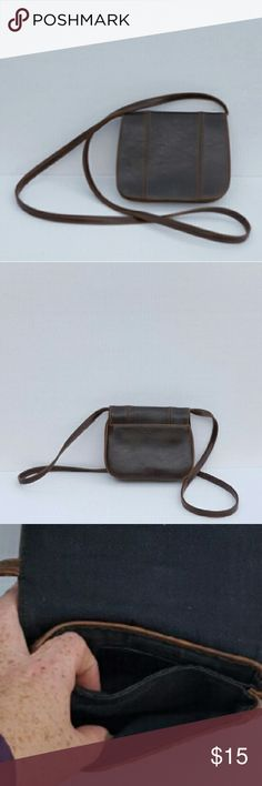 Liz Claiborne Bag Brown synthetic leather crossbody bag. Measures approximately 7 (L)x 5.5 (H)x 1 (D). Magnetic snap closure on the flap. Inside contains two small compartments large enough for a cell phone. Strap drop length of approximately 22 inches. Great little purse looking for a new home Liz Claiborne Bags Crossbody Bags