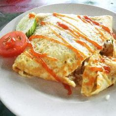 Nasi Goreng Pattaya (Stuffed Omelette Fried Rice)--- Despite its Thai sounding name, nasi pattaya originated from Malaysia. Its a simple fried rice in omelette parcel ; available at malay hawker stalls and usually served with sliced cucumber, tomato and drizzled with ketchup or chilli sauce.