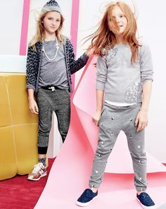J.Crew girls' leopard bomber-sweater, chevron-trim sweatpant, leopard cap, jersey T-shirt, pearl petal necklace, trouser socks three-pack and New Balance® for crewcuts 996 sneakers in rose gold. J.Crew girls' sequin cluster popover sweater, slim slouchy sweatpant in metallic stars, supersoft V-neck T-shirt and slide sneakers in glitter.