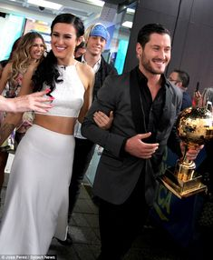 Victorious: Dancing with the Stars champs Rumer Willis and Val Chmerkovskiy - Mirror Ball trophy in hand - appeared on Good Morning America in Manhattan Wednesday