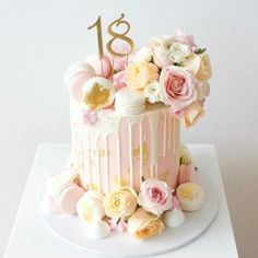 Gorgeous pink pastel cake with roses and macarons - this would be perfect for a bridal shower or wedding!