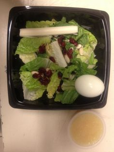 Lite Lunches : Romaine Salad with dried cranberries, slivered almonds and poppyseed dressing with a cheese stick, apple sauce, hard boiled egg and dark chocolate. Only 375 calories!