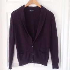 Plum Cardigan This cardigan is a wonderful staple piece. Features 3 buttons and two small pockets at the bottom. Made with a touch of cashmere for a soft feel! Cotton, nylon, cashmere blend. GAP Sweaters Cardigans