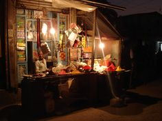 An Indian spice shop at night.