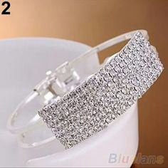 Silver bracelet New and high quality full rhinestone beaded cuff bangle A perfect ornament to make your wrist slim and charming 2 layers metal chain, so special and sweet and fashion Also a nice gift to your friends, sisters or relatives Material: alloy & rhinestone Diameter: 5cm/1.97'' (Approx Jewelry Bracelets