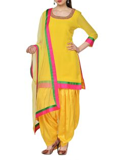 Make heads turn this festive season with this stunning yellow suit set. Beautifully designed, it features an embellished knee-length flowy georgette kurta with green and pink panels on the quarter sleeves and hem. Accompanied by a glossy shantung patiala salwar and matching net dupatta, it is sure to please every eye that sets on it. Pair this pretty ensemble with towering heels and ethnic gold jhumkas to ace this look.