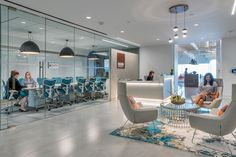 Margulies Perruzzi Architects designed the offices for real estate investment trust AvalonBay Communities, located in Boston, Massachusetts. Estate Law, City Office, Cove Lighting, Waiting Area, Buying A New Home, Real Estate Development, California Homes, Architect Design, Real Estate Investing