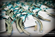 How about a horseshoe for each of your guests to wish everyone good luck!  It could fit a country themed wedding for sure!