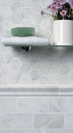 Never seen marble hex used as a wall tile... like the contrast with the marble subway tile! separated with marble chair rail.