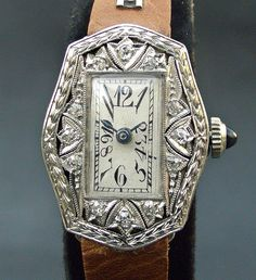 Art deco watch with diamonds and exploding dial.  Band doesn't go at all, but the rest is spectacular.