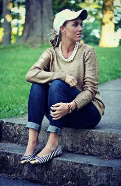 Very easygoing for spring. I wouldn't wear the hat because it would make me look like a boy. Crewneck sweater. Cuffed jeans. Flats.