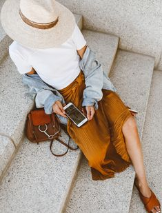 We're loving Hello Fashion Blog's Minimal Summer Outfit : Plain White Tee, Tie Front Vince Skirt, Oversized Denim Jacket, Vince Slides, Tortoiseshell Sunglasses, Straw Hat and Chloe Crossbody Bag minimal summer outfit