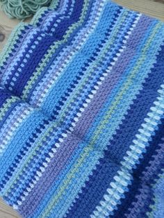 1dc 1 ch, then the next row you work the double crochet into the one chain space and then a chain, so it all interlocks and gives a lovely dense yet flexible fabric which is soft and very warm.