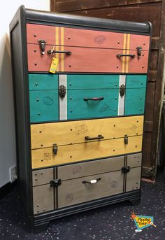 """This great waterfall dresser was hand-painted to be a one-of-a-kind suitcase dresser. The drawers include """"travel stamps"""" on the front and sides. Accumulating all of the hardware to make it look real was the most time-consuming part. And people who see it actually think it has suitcases in it! Mission accomplished :-)"""