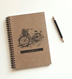 Not All Who Wander Are Lost Hand Stamped Spiral Notebook Journal Bicycle. $9.95, via Etsy.