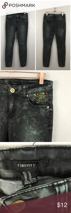 """Forever 21 Black Distressed Studded Skinny Jeans Forever 21 Black Distressed Studded Skinny Jeans. Size US 27 with stretch. Very trendy and perfect for fall time! Thank you for looking at my listing. Please feel free to comment with any questions (no trades/modeling).  •Fabric: 76% Cotton 22% Polyester 2% Spandex  •Inseam: 28"""" •Condition:  EUC, no flaws.   25% off all Bundles or 3+ items! Reasonable offers welcome.   BIN: LC Forever 21 Jeans Skinny"""