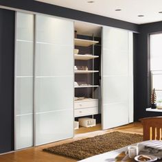 Four Panel White Glass Sliding Door - Silver framed - 610mm at Homebase -- Be inspired and make your house a home. Buy now.
