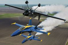 The Blue Angels lead solo, Navy Lt. Ryan Chamberlain, and opposing solo, Capt. Jeff Kuss, get into position below performer Rob Holland for a photo opportunity during Wings Over South Texas 2016 at Naval Air Station Kingsville, Texas, April 7, 2016. Navy photo by Petty Officer 2nd Class Ian Cotter