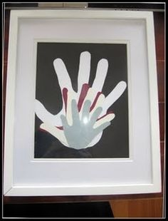 fathers day -dads handprint with each child's handprint on top