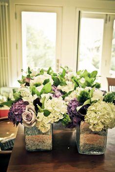 Vermont wedding flowers: Hydrangeas, roses, and calla lilies in elegant, simple vases.