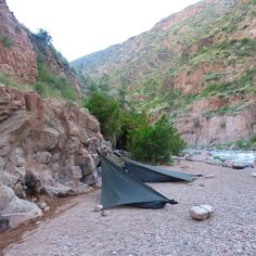 Of course we could stay at a proper campsite but then we wouldn't get spend the night cooking by the fire at the bottom this ravine and fall asleep to the sound of the rapids. We managed to rig our @hennessyhammock to the rock face and secured the other end to a large rock. Good thing they can work as a tent because it can be hard to find trees in this dessert sometimes. #velovoyagers #argentinabybike #cycletouring #cycling.