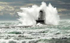 A storm surge engulfs Lake Michigan's 57-foot-tall Ludington Lighthouse. Description from regions.noaa.gov. I searched for this on bing.com/images