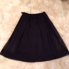 Anthropologie UK sheer black pleated skirt NWOT Anthropologie UK sheer black pleated skirt NWOT. Hard to photograph. Top skirt is sheer with wide pleats. Gorgeous on and moves beautifully. Made in France Anthropologie Skirts