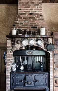 Amazing rustic #kitchen, complete with a wood-burning stove and brick chimney. Food will never taste the same on an electric stove again!