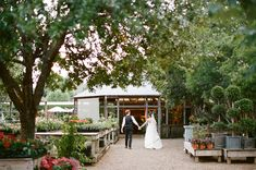 wedding held at a plant nursery.... this is what i've been wanting to do!