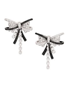 Chanel's Ruban Couture earrings MD in 18K white gold set with 238 brilliant-cut diamonds, and 96 round-cut black diamonds.   - ELLE.com