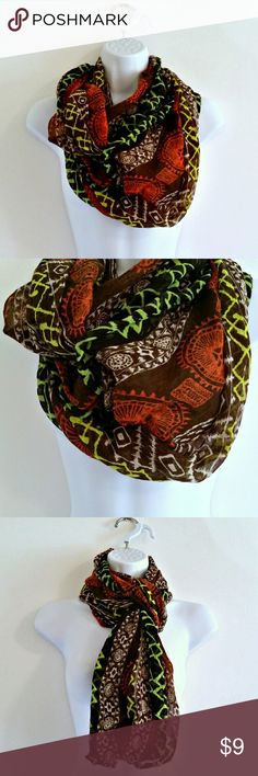 "(415) Earthy Shades Ethnic Infinity Scarf Super soft & lightweight infinity scarf in earthy, boho shades. I love the lime green and bold orange details. Multiple ways to wear - and light enough for layering without being too warm.   Size - 33"" x 36""  Color may vary slightly based on screen display.  #scarf #infinityscarf #boho #bohostyle #bohofashion #bohemian #bohemianstyle #bohemianfashion #bohoscarf #bohemianscarf #bohoinfinityscarf #earthycolors #neutrals #earthyshades #brownscarf…"