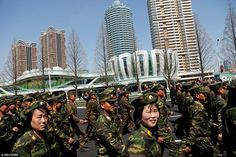 Male and female soldiers were even brought in to celebrate the grand opening of the apartm...