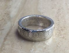A very nice coin ring made from an 1958 Italian silver 500 Lira Coin. The ring was made as a commission for a client who has bought a few rings from myself. The ring is a UK size T1/2 the silver co…