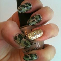 Camo nails got a girlie upgrade with a flash of gold polish.  Source: Instagram user dawn_nails_jones