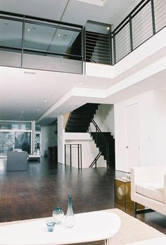 View of loft rail and stairway from living space.