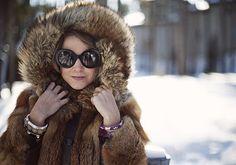 Mom's vintage fox fur + Prada shades + stacked bracelets.