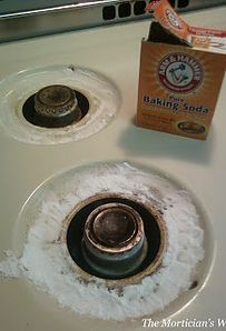 Pour on a thick coat of baking soda. Follow with a tablespoon of hydrogen peroxide onto each burner