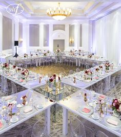 GREAT TABLE LAYOUT . UNIQUE !! WIPA Las Vegas Launch at The Four Seasons Las Vegas Tables and Chairs by STYLE Event Design Centerpieces by Naakiti Floral Photo by www.altf.com