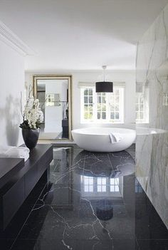 Extravagant bathroom with marble all over and a big big tub... A place to relax!