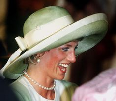 The Princess of Wales arrives in Lagos, Nigeria, for an official visit, March 1990. She wears a green Catherine Walker suit and Philip Somerville hat